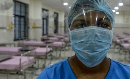 A medical staff wearing a facemask poses in an isolation ward at a newly inaugurated hospital by the Tamil Nadu state during a government-imposed nationwide lockdown as a preventive measure against the COVID-19 coronavirus, in Chennai on March 27, 2020.