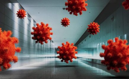 Red microbes are displayed enlarged in a hallway.