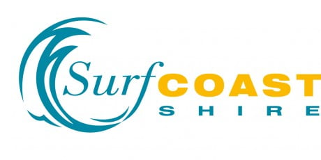 surf coast shire logo with blue curved shape surrounding the word surf, coast in yellow and shire in blue again