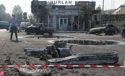 Vehicles damaged in the 28 October 2020 shelling attack in a street. The fighting between Armenia and Azerbaijan over Nagorno-Karabakh resumed in late September with both countries accusing each other of provocation, declaring martial law, and mobilising their armed forces
