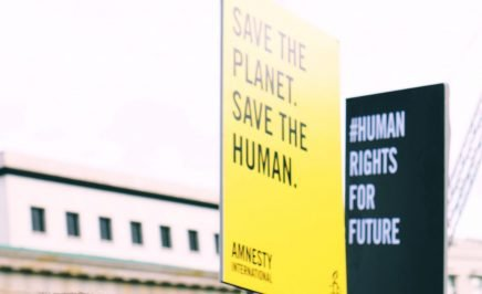 Amnesty climate placards
