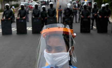 A resident of Paraisopolis, one of the city's largest slums, takes part in a protest in Sao Paulo, Brazil, on May 18, 2020, to demand more aid from Sao Paulo's state government during the COVID-19 coronavirus pandemic.