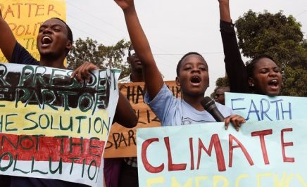 Young people hold up banners as they take part in a march, part of the global Climate Walk 2019, against climate change in Wakiso, on September 20, 2019.