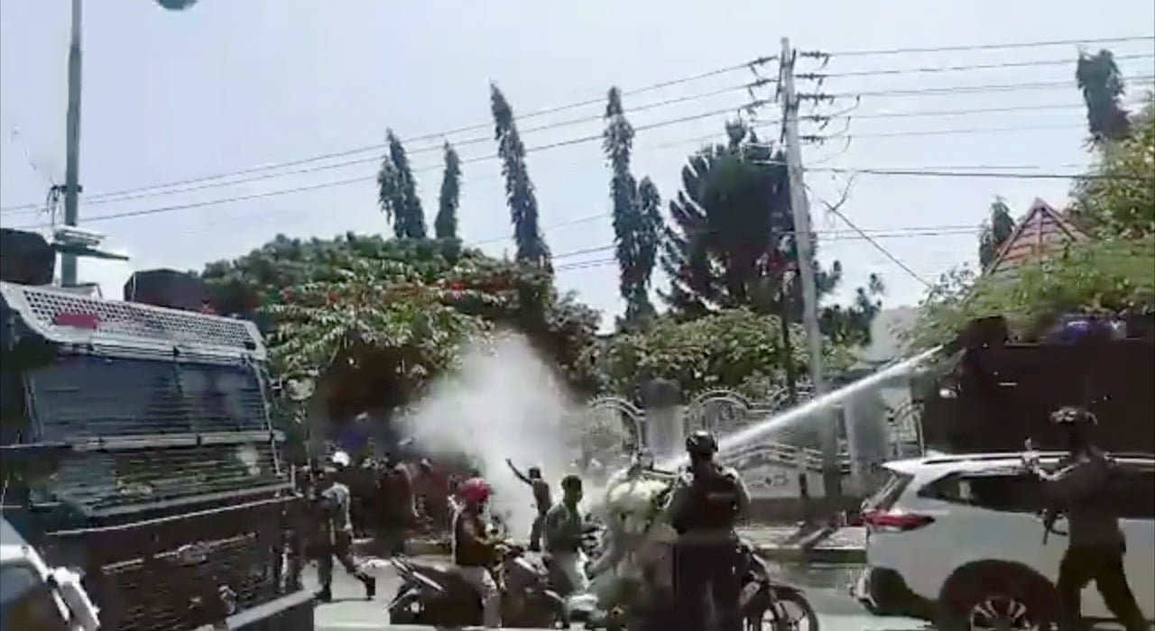 Video Still showing the use of water cannon against protestors in West Papua