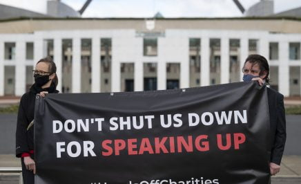 Don't Shut us Down for Speaking Up banner held in front of Parliament House