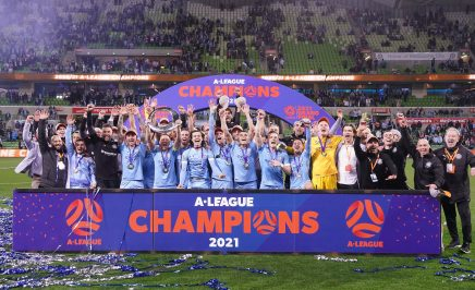 Melbourne City captain, head coach and players celebrate with trophy after winning the A-League Grand Final match between Melbourne City and Sydney FC at AAMI Park in Melbourne, Sunday, June 27, 2021.